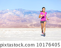 Running sport athlete woman sprinting in trail run 10176405