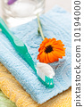 Toothbrush with toothpaste on fresh towels 10194000