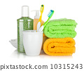 Toothbrushes, cosmetics bottles and two towels 10315243