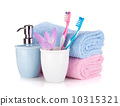 Toothbrush, soap, two towels and flower 10315321