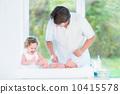 father, newborn, diaper 10415578