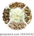 assorted mushrooms with onions on a white background in the restaurant 10434242