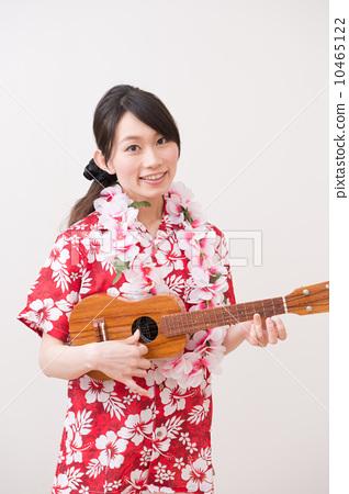 A woman in an Aloha shirt 10465122