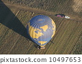 A balloon returning to the ground 10497653
