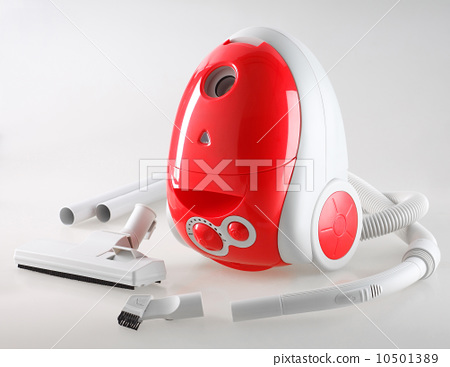 Red vacuum cleaner with accessories isolated 10501389