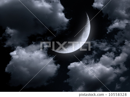 The moon in the night sky in clouds 10558328