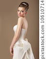 Formal Party. Rich Woman in White Dress with Bow Knot 10610714