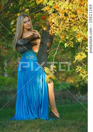 Fashion portrait of young sensual woman in garden 10621169