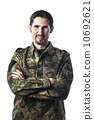 Man with camouflage 10692621