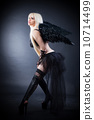 Blond female angel with black wings on a black background 10714499