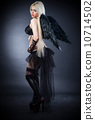 Blond female angel with black wings on a black background 10714502