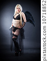 Blond female angel with black wings on a black background 10718852