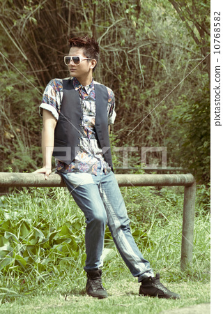 Asian man in printed polo 10768582