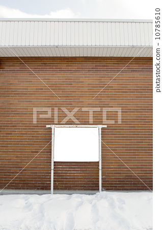 Empty billboard on brick wall 10785610