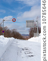speed limit sign on the snowy road 10785646