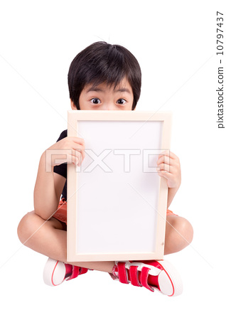cute boy is looking out from the blank banner, isolated over whi 10797437