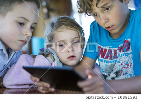 Caucasian children playing games on tablet computer 10881593