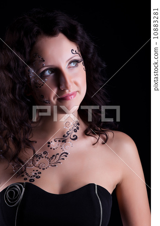 Brunette woman with art makeup 10883281