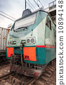 Modern green cargo train locomotive with red signs 10894148