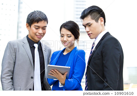 Three business office worker looking at tablet 10901610