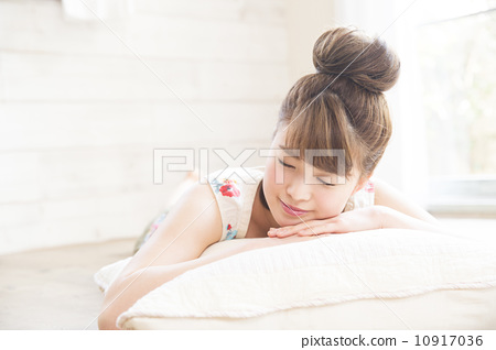 A young lady sleeping on his face 10917036