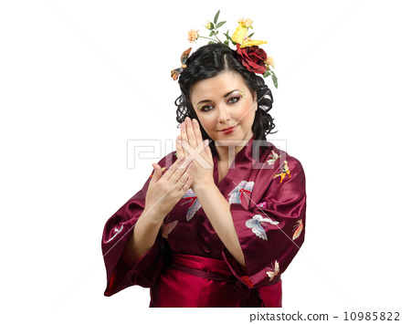 Kimono woman showing traditional gestures 10985822