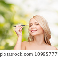 beautiful woman with closed eyes and makeup brush 10995777