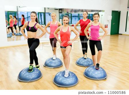 group of female doing aerobics with half ball 11000586