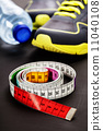 Sport shoes and measuring tape 11040108