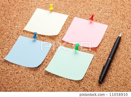 Blank postit notes on cork notice board 11058910