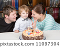 Little boy celebrating his birthday at home with his parents 11097304