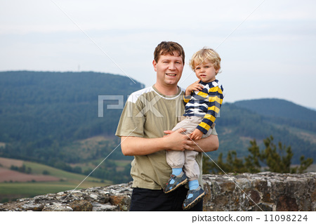 Young father and his little son outdoors 11098224