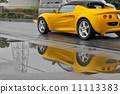 Yellow car reflected in a puddle 11113383