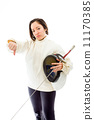 Female fencer showing thumbs down sign 11170385