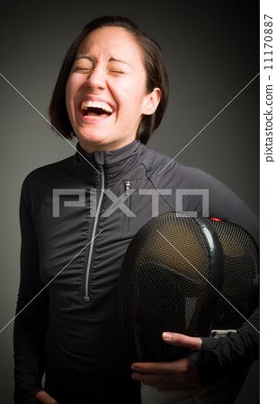 Female fencer laughing 11170887