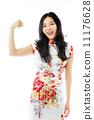 Asian young woman flexing biceps 11176628