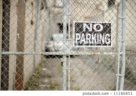 No parking sign behind chainlink fence 11180851