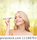 beautiful woman with closed eyes and makeup brush 11188763