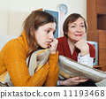 unhappy mature mother and crying adult daughter 11193468