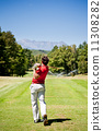 Golf player performs a tee shot 11308282