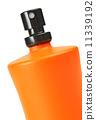 orange small bottle with a perfume liquid 11339192