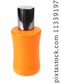 orange small bottle with a perfume liquid 11339197