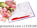notebook with flowers by a heart and inscription 11339198