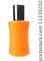 orange small bottle with a perfume liquid 11339202