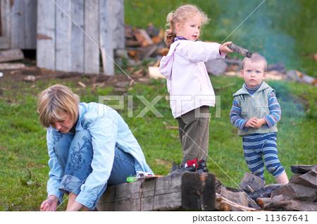 Family near campfire 11367641