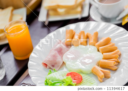 Breakfast with fried eggs, sausage, toast and coffee 11394617
