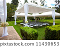 wedding marquee with bouquets of roses 11430653