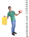 Portrait of young man with shopping bag and gift 11454442