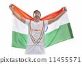 Happy male hockey player celebrating victory with Indian flag isolated over white background 11455571