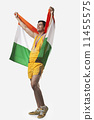 Happy male medalist celebrating victory with Indian flag against white background 11455575